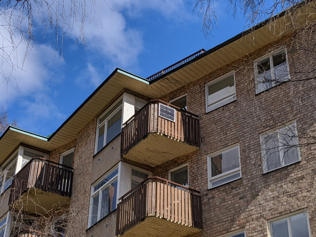 Balcony with a solar panel on a sunny day.