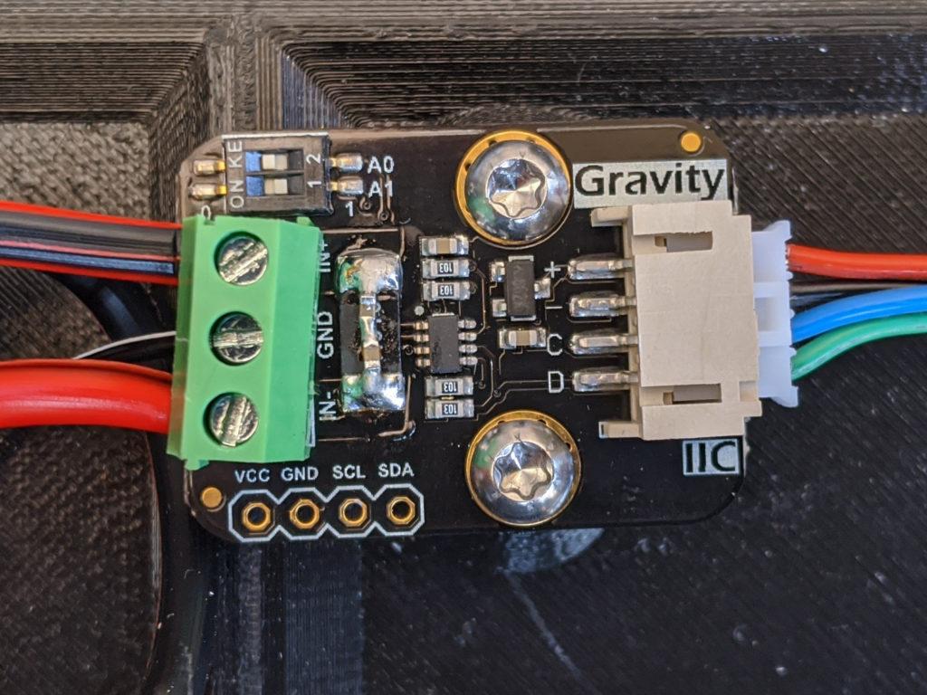 DFRobot I2C wattmeter with soldered capacitors.